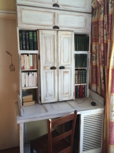 Bookcase of old wood, doors and window shutters